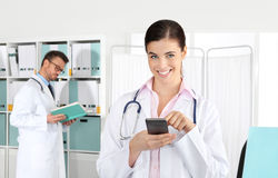 Doctor smiling on the phone, concept of medical booking Royalty Free Stock Images