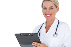 Doctor smiling with stethoscope around her neck Stock Photography
