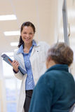 Doctor smilling to senior patient Royalty Free Stock Image