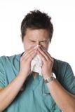 Doctor sneezing isolated against white Royalty Free Stock Image