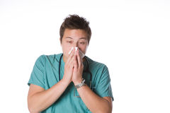 Doctor sneezing isolated against white Royalty Free Stock Photo