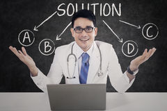 Doctor with solution choices Stock Images