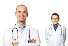 Doctor sonriente aislado en blanco Foto de archivo
