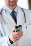 Doctor speaking on cellphone Stock Photography