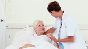 Doctor speaking with her patient stock video footage