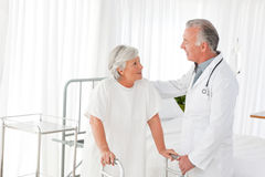 Doctor speaking with his patient Stock Images