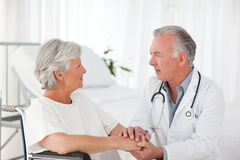 Doctor speaking with his patient Royalty Free Stock Image