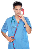 Doctor speaking on the phone Royalty Free Stock Photography