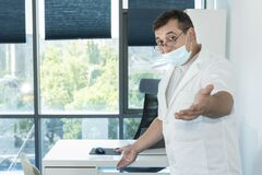 Free Doctor Specialist During The Pandemic With Covid Virus Royalty Free Stock Photo - 194615825