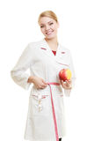 Doctor specialist holding fruit apple measuring waist Stock Images
