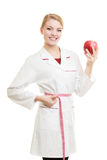 Doctor specialist holding fruit apple measuring waist Royalty Free Stock Images