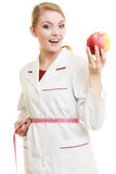 Doctor specialist holding fruit apple measuring waist Royalty Free Stock Photos