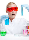Doctor in spectacles does some experiments Royalty Free Stock Photos