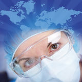 The doctor in spectacles and in a mask Stock Photography