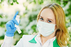 Doctor with spray inhaler Stock Photography