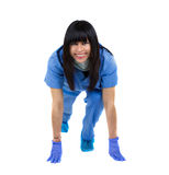 Doctor in sprint position. Doctor in position ready to run  isolated over a white backround Stock Photography