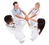 Doctor stacking their hands together Stock Photo