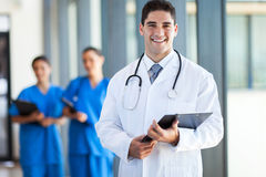Doctor and staff Stock Images