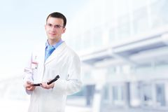 Doctor stand near the Hospital main Entrance. Stock Photo