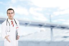 Doctor stand near the Hospital main Entrance. Stock Photography
