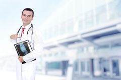 Doctor stand near the Hospital main Entrance. Stock Images
