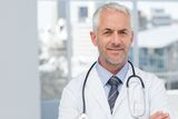 Doctor standing with arms folded Stock Photo