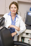 A Doctor Standing By A Computer Monitor Stock Images