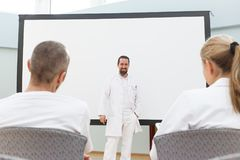 Doctor is standing in front of a empty whiteboard royalty free stock photography