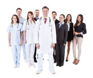 Doctor standing in front of his team Stock Image