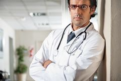 Doctor Standing With Hands Folded Royalty Free Stock Photography