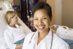Doctor Standing In Her Patients Room. Smiling to Camera stock photo