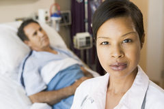 Doctor Standing In Hospital Room Stock Photos