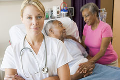 Doctor Standing In Hospital Room. With Her Arms Folded stock images