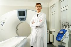 Doctor standing near computed tomography scanner Royalty Free Stock Photo