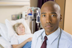 Doctor Standing In Patients Room royalty free stock images