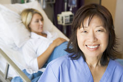 Doctor Standing In Patients Room. Smiling stock images