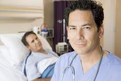 Doctor Standing In Patients Room Stock Image