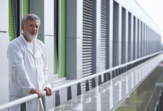 Doctor standing on the roof of the research center Royalty Free Stock Photo