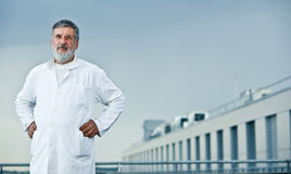 Doctor standing on the roof of the research center Royalty Free Stock Images