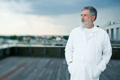 Doctor standing on the roof of the research center Stock Photo