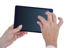 Doctor standing with tablet pc Stock Photos