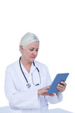 Doctor standing with tablet pc Royalty Free Stock Images