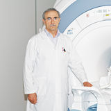 Doctor standing at tomograph Royalty Free Stock Photo