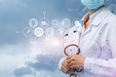Doctor stands on the background of medical service icons . Royalty Free Stock Photos