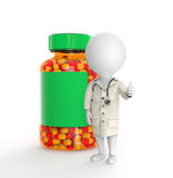 Doctor stands near pills bottle Stock Photos