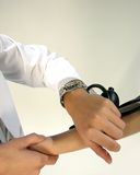 Doctor with stethoscope. Young pretty doctor with stethoscope on white Stock Images