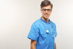 Doctor With Stethoscope Around his Neck Against Grey Background Royalty Free Stock Image