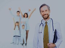 Doctor with stethoscope around his neck looking at the camera. Smiling medical doctor and happy family Royalty Free Stock Images