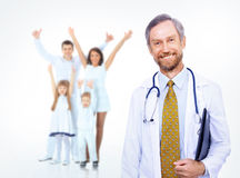 Doctor with stethoscope around his neck looking at the camera. Smiling medical doctor and happy family Stock Photo