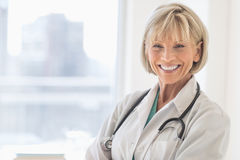 Doctor With Stethoscope Around Neck In Hospital Royalty Free Stock Images